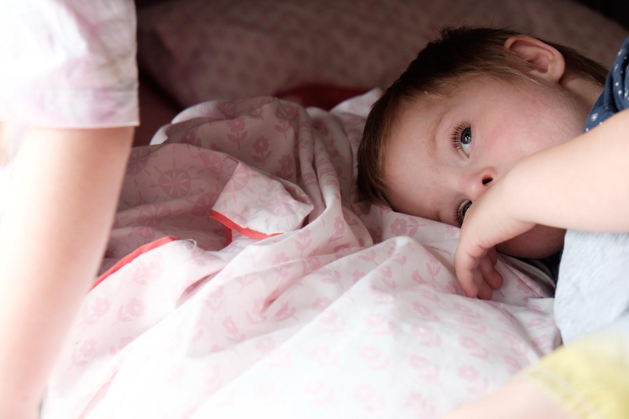Child on Bed, Awake