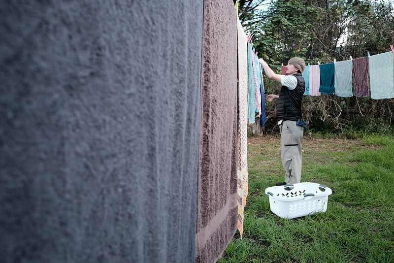 Man Hanging out Towels to Dry
