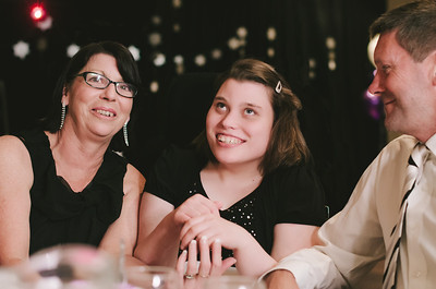 Young Woman with a Disability at a Ball with her Parents
