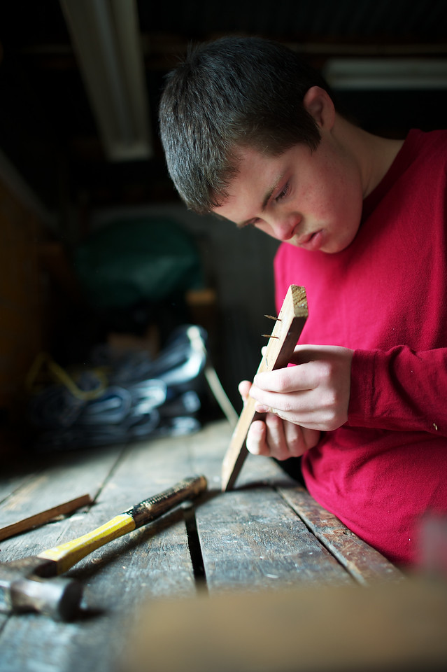 15 year old doing woodwork in his workshop