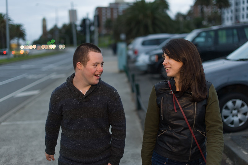 Young Man and Woman walking on a Footpath in St Kilda