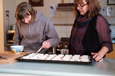 Support Worker and Woman Making Sausage Rolls
