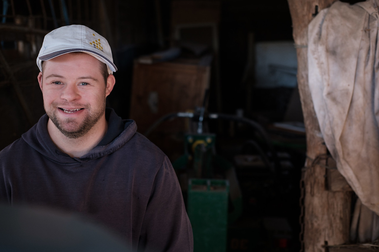 Smiling Young ,Man in a Work Setting