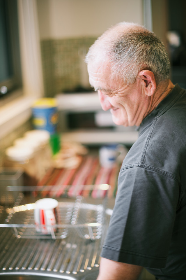 Man standing in his kitchen, smiling