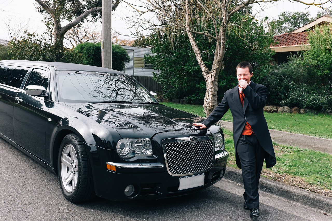 Young Man in a Morning Suit Leaning on a Limo