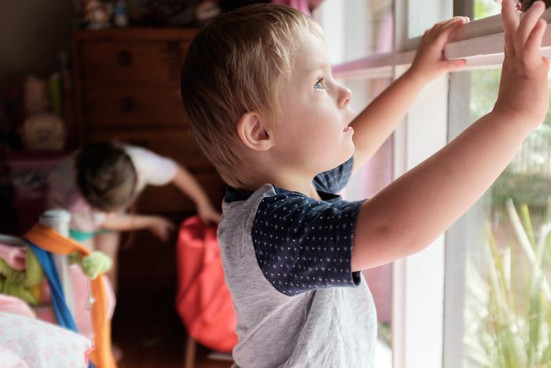 Little Boy at Bedroom Window