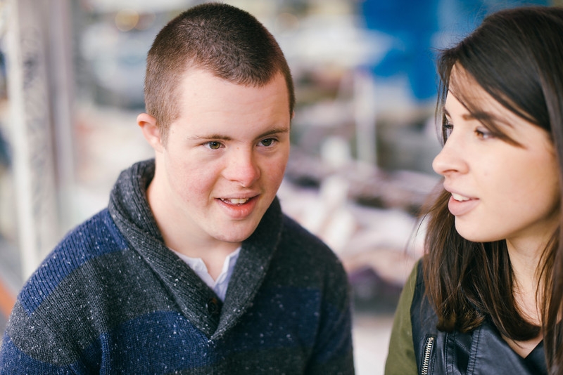 Seventeen-Year-Old boy with Down Syndrome with a Young Woman of Twenty.
