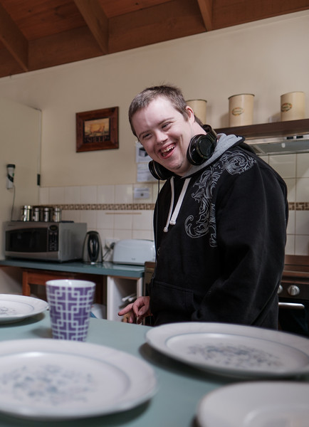 Young Man in Kitchen About to Dish Up Meal