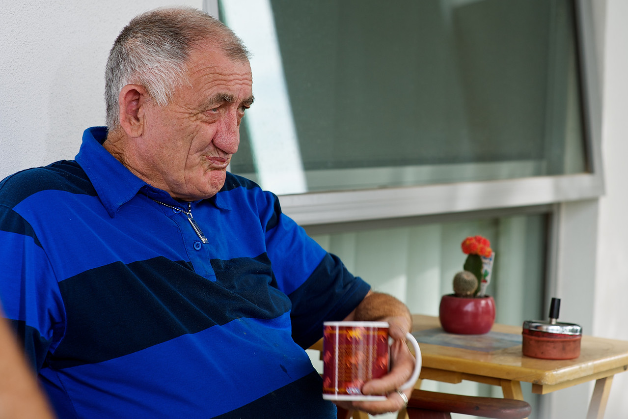 Man having a cuppa on his front porch