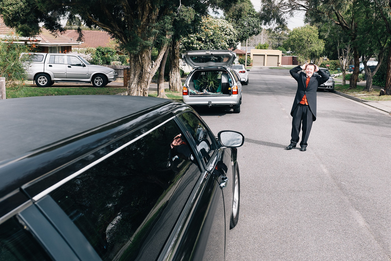 Young Man in Morning Suit thrilled with Limo