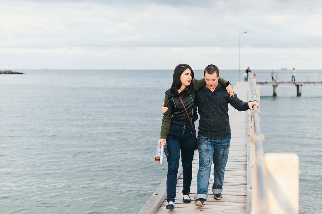 Teen with Down Syndrome and Young Woman on a Jetty