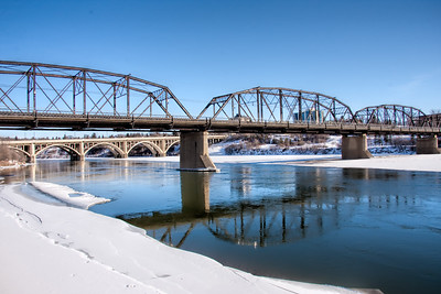 Blue river reflections in the City of Bridges