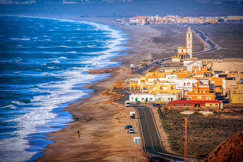 View of La Almadraba de Monteleva and San Miguel de Cabo de Gata (background), Gata Cape, Almeria, Andalusia, Spain