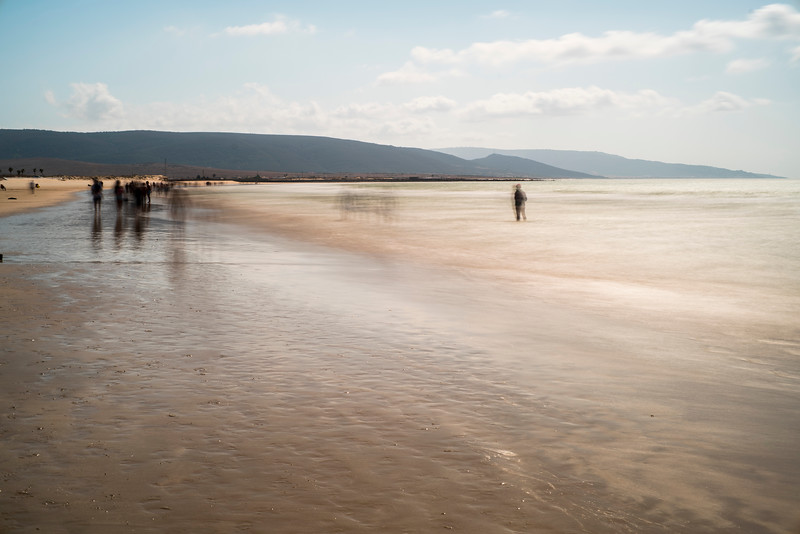 Ghostly people on a beach, long exposure shot, Playa del Carmen, Barbate, Andalusia, Spain.