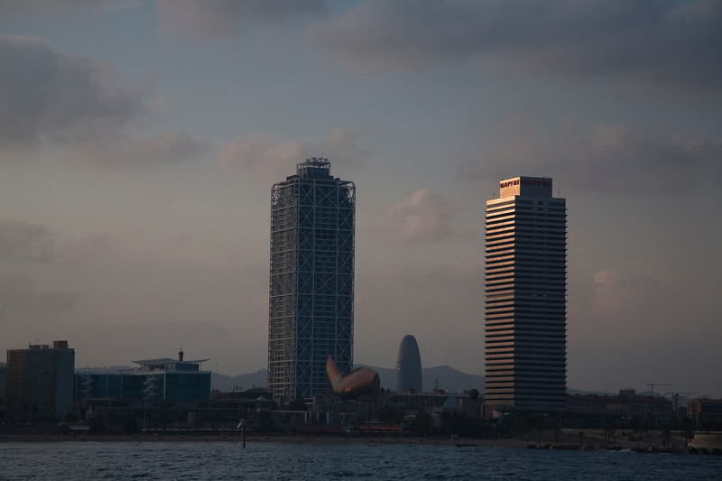 Barcelona skyline from the Mediterranean sea with the Hotel Arts (left) and Mapfre building towers. Town of Barcelona, autonomous commnunity of Catalonia, northeastern Spain