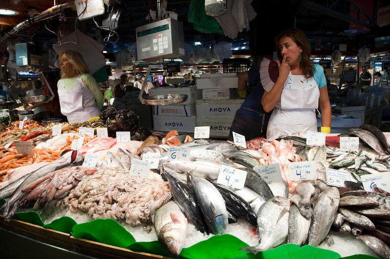 Fishmonger. Boqueria market, town of Barcelona, autonomous commnunity of Catalonia, northeastern Spain