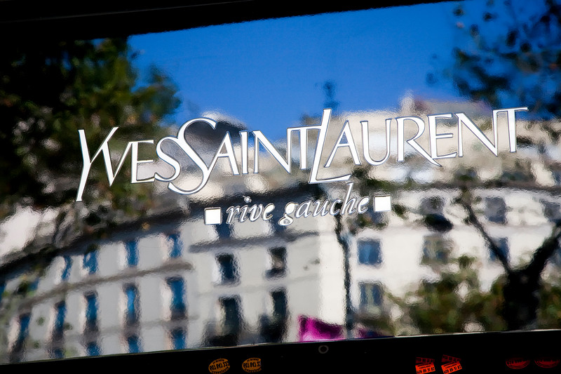 Reflections on Yves Saint Laurent shop sign, Passeig de Gracia, town of Barcelona, autonomous commnunity of Catalonia, northeastern Spain
