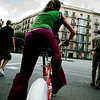 Young girl riding a public service bike, town of Barcelona, autonomous commnunity of Catalonia, northeastern Spain