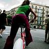 Young girl riding a public service bike, town of Barcelona, autonomous commnunity of Catalonia, northeastern Spain