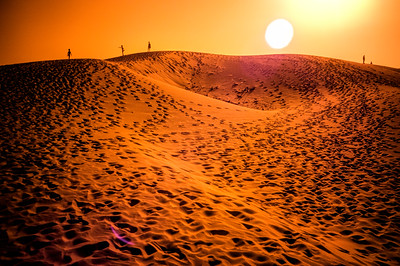 People's silhouettes on the top of Bolonia dune, Tarifa, province of Cadiz, Spain. Infrared image.