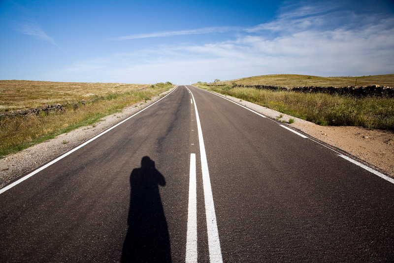 The shadow of a man on a lonesome road, province of Caceres, autonomous community of Extremadura, Spain