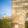Alcantara bridge triumphal arch with Las Monjas convent on the background, town of Alcantara, province of Caceres, autonomous community of Extremadura, southwestern Spain