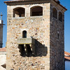 Tower of Golfines de Abajo palace with storks on the top. Caceres, Spain