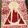 Mosaic made with flowers to honor the Virgin on the facade of Caceres Cathedral, Spain