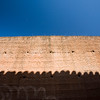 The shadow of a roof on the medieval city walls of Caceres, Spain