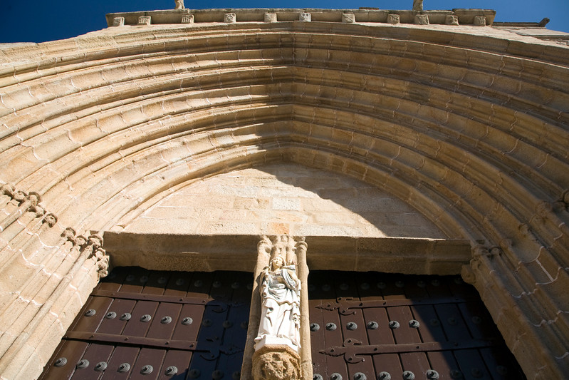 Low angle view of the ogival doorway of Caceres Cathedral, Spain