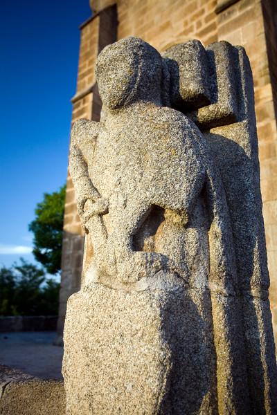 Granite warrior in front church of Santa Maria de Almocovar, town of Alcantara, province of Caceres, autonomous community of Extremadura, southwestern Spain