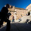 Man climbing Plaza Mayor stairs, Caceres, Spain