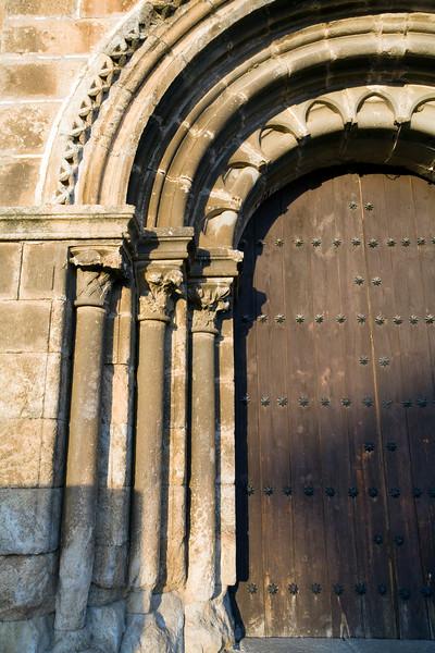 Detail of the Romanesque facade of the church of Santa Maria de Almocovar, built over a former mosque, town of Alcantara, province of Caceres, autonomous community of Extremadura, southwestern Spain