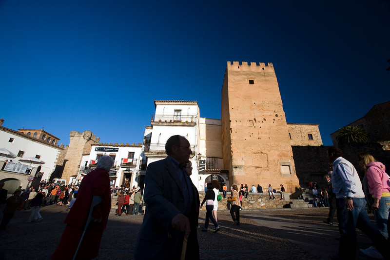 Plaza Mayor and the brown Torre de la Hierba (Grass Tower, 12th century), Caceres, Spain