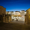 Plaza Mayor at dusk, as seen from Arco de la Estrella, Caceres, Spain