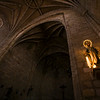 Image of the Virgin lit with electric candles, Santos Martires church, Brozas, Caceres, Spain