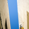 Colorful, abstract low angle image of the sky above a typical narrow street, Cadiz, Spain
