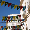 Colorful image of a Cadiz street decorated with pennants