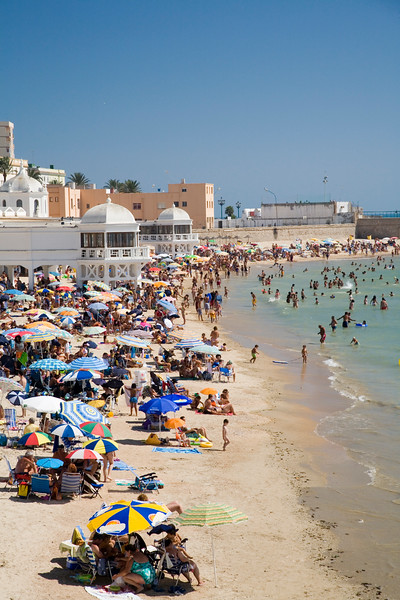 La Caleta Beach is a small and very popular urban beach located in Cadiz city center, Spain. The elegant white building of La Palma spa gives it an unique touch.