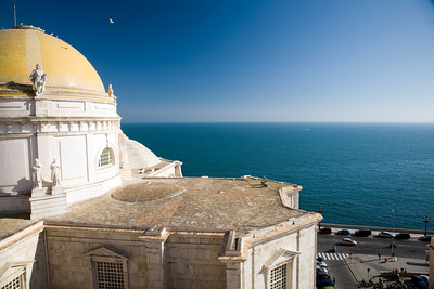 View of the golden dome and the vaults of the cathedral from the highest point in the city of Cadiz: the cathedral western tower. You can see the sea on the background.