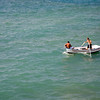 A single rowboat on the sea