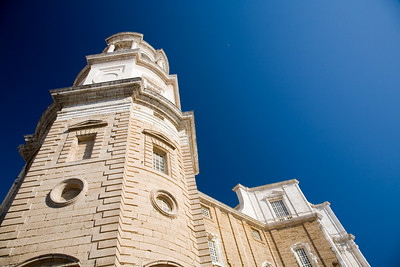 Colorful image of Cadiz Cathedral from a low angle view.