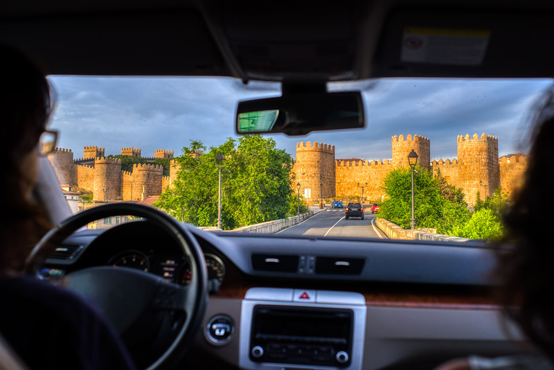 The medieval walls of Avila from a moving car, Spain