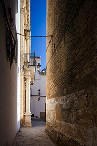 Typical Mediterranean architecture with whitewashed walls and narrow streets in the historical city of Carmona, province of Seville, Spain