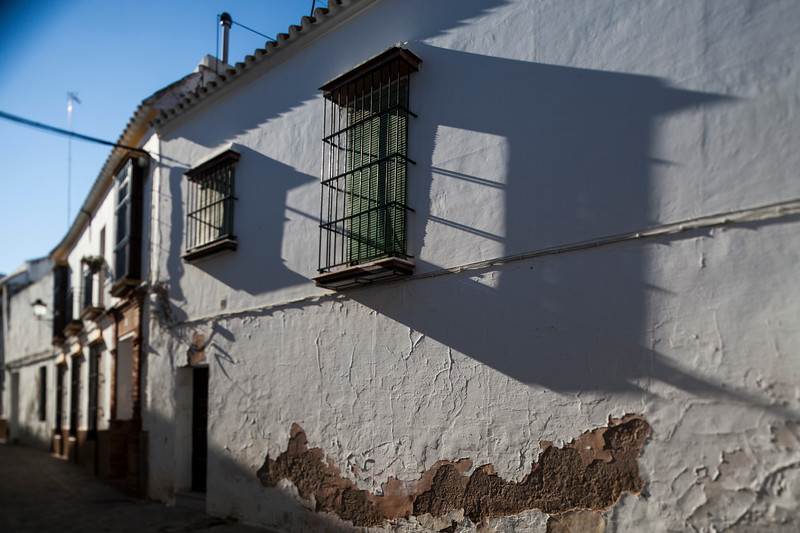 Typical Mediterranean architecture with whitewashed walls and narrow streets in the historical city of Carmona, province of Seville, Spain. Tilted lens used for shallower depth of field.