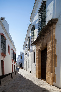 Casa Antigua del Ave Maria, typical Mediterranean architecture with whitewashed walls and narrow streets in the historical city of Carmona, province of Seville, Spain