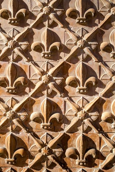 Fleurs de lis, detail from a facade, town of Carmona, province of Seville, Spain