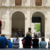 Visitors taking a break at Kings' square, El Escorial, Spain
