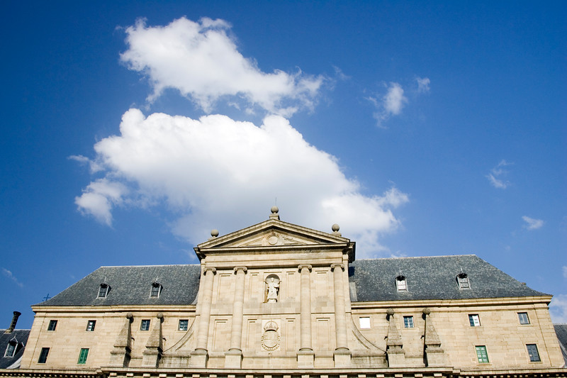 The Ionic style pediment and columns on the top of El Escorial facade, Spain