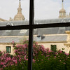 The top of El Escorial dome viewed through a very old window with ancient glass